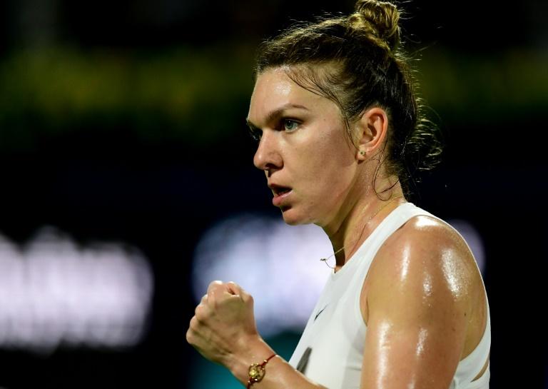 Halep beats Mertens to win WTA Prague Open