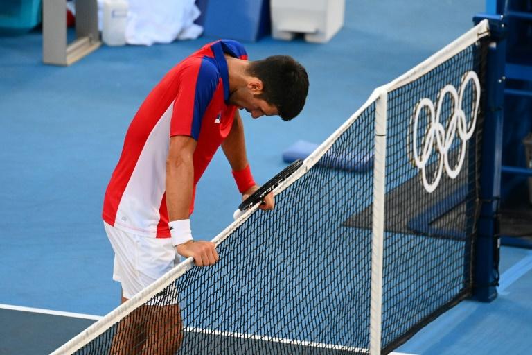JO-2020 -  Djokovic repart bredouille, et blessé, de Tokyo