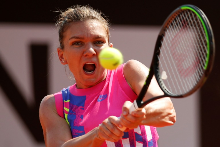 Top seed Halep eases into Italian Open third round