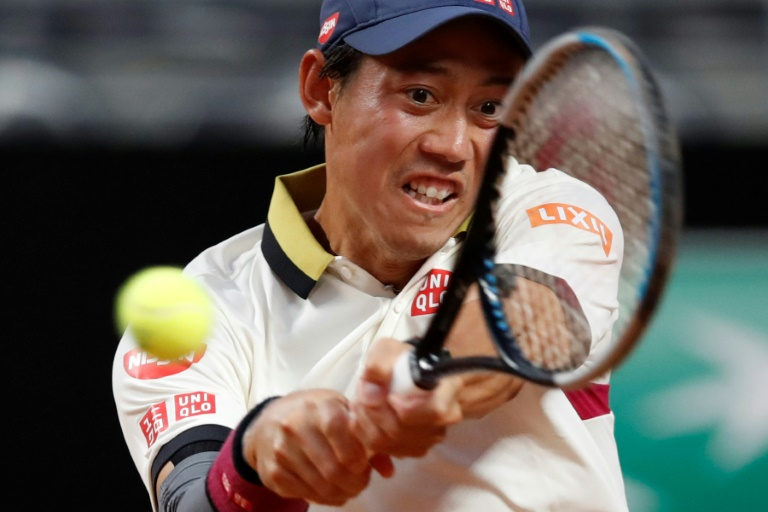 Nishikori finds feet on Rome clay with first win in a year
