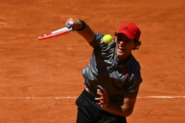 Thiem battles past Isner to reach semi-finals in Madrid